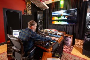 Mastering engineer in studio using Wavelab 10 to master audio.