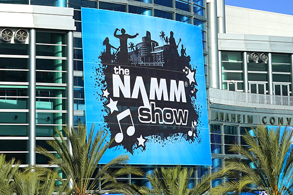 Outside view of Anaheim Convention Center with NAMM 2020 advertised on screen.