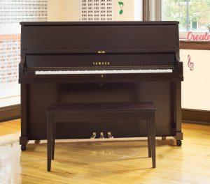 Upright studio piano.