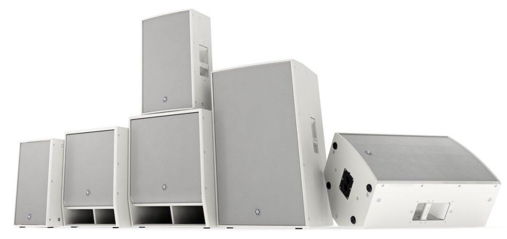 Set of six white rectangular speakers.