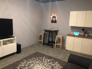 A room showcasing smart home features including smart lights, a smart TV, and several MusicCast audio products.