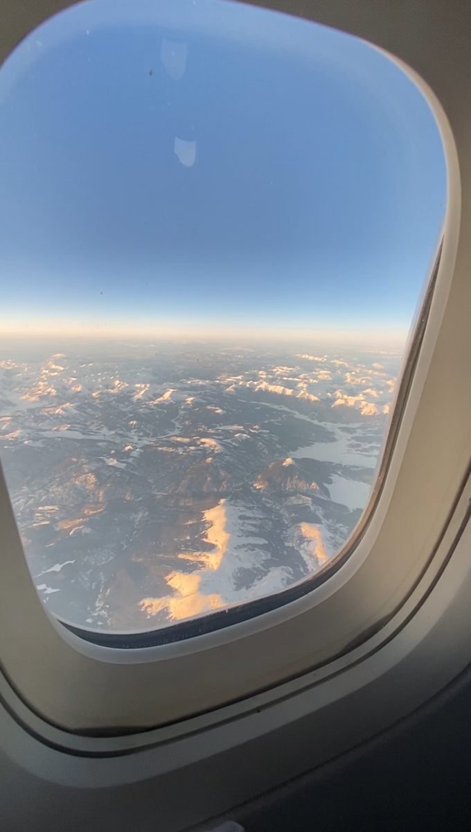 View of the Grand Canyon from the window of an airplane.