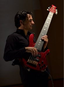 Man holding a guitar.