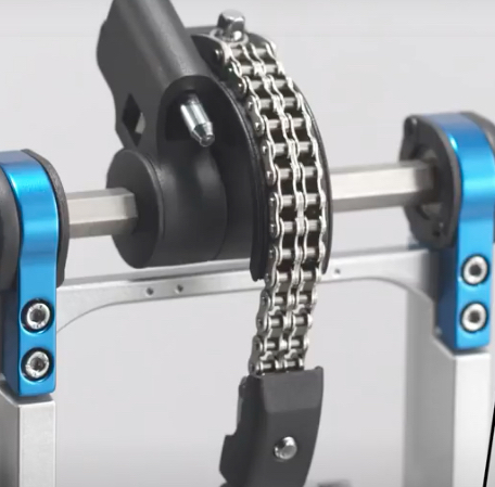 Close-up shot of a dual chain drive on a drum pedal.