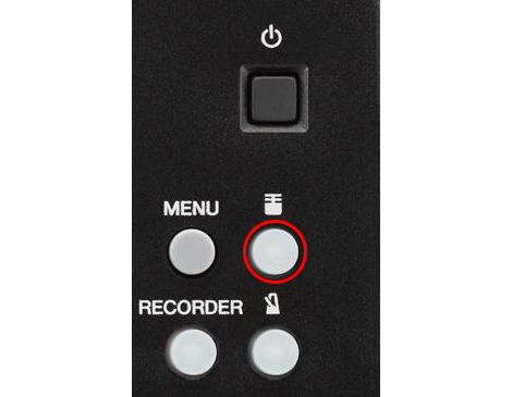 Microphone button on acoustic electronic drum module.