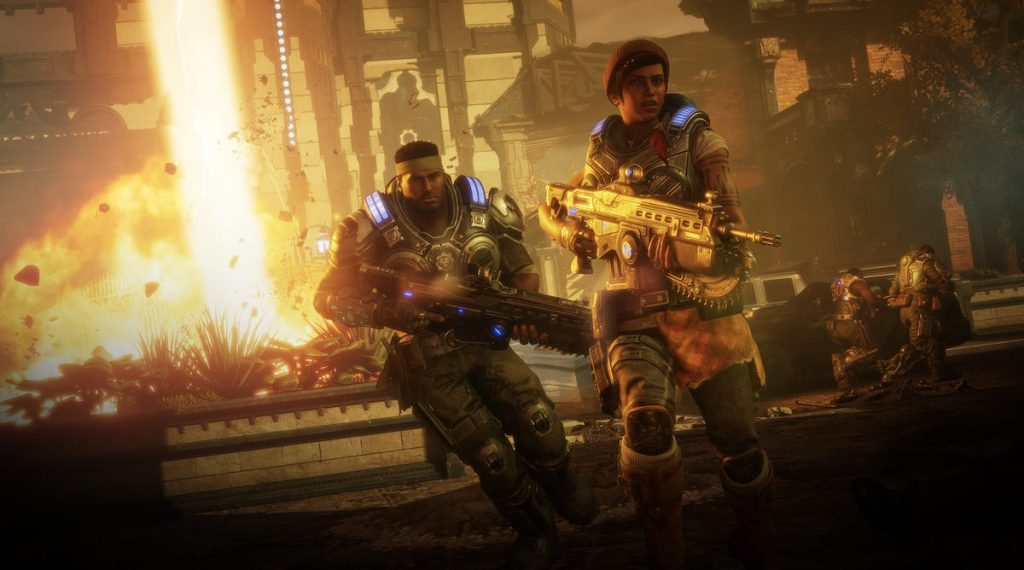 Energetic scene from Gears 5 with fiery explosion in background.
