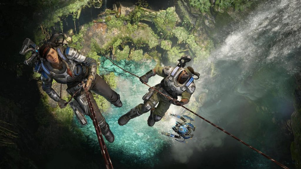 Characters descend from rope into a cave pool in scene from Gears 5.