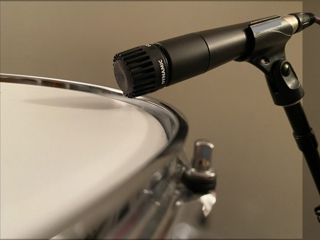 Microphone placed near drum head.