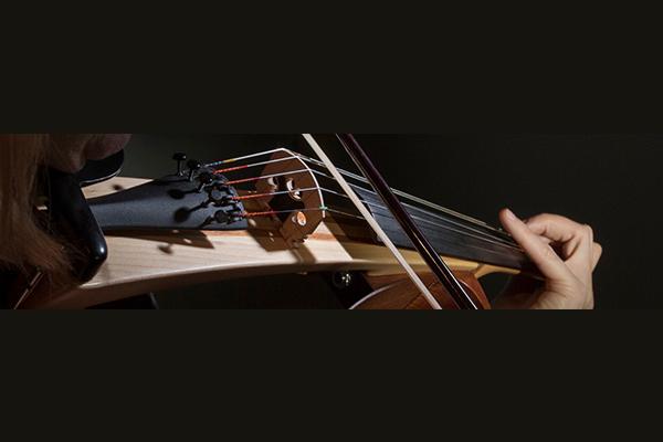 Woman playing Yamaha SILENT violin.