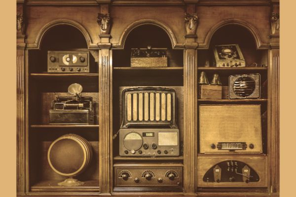 Built-in shelving with vintage audio devices.