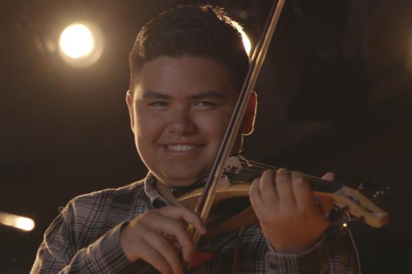 Young man playing Yamaha Electric Violin (YEV).