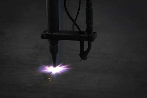 Laser cutting through metal.