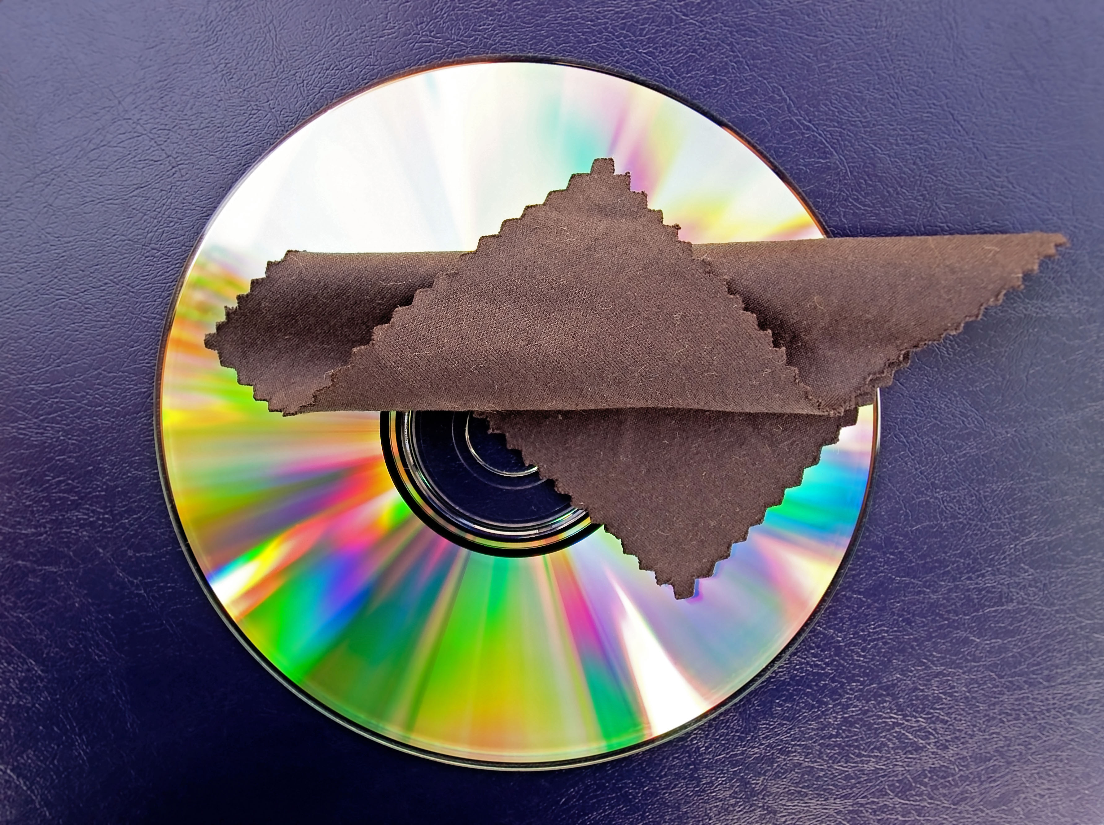 Microfiber cleaning cloth on cd.