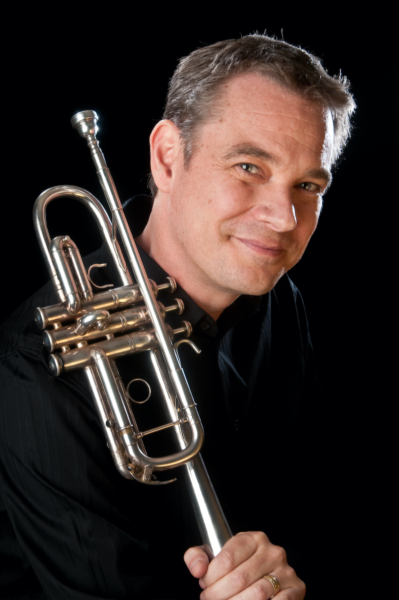 Portrait of Ryan Anthony with his trumpet.