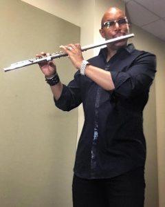 Scott Mayo playing the flute.