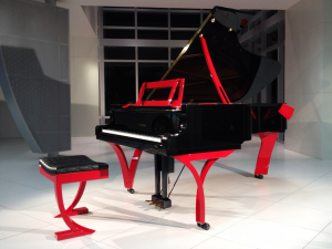 Customized Yamaha grand piano, black with red trim.