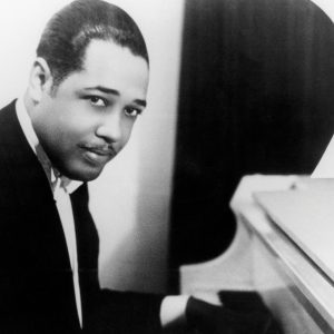 Duke Ellington playing piano.