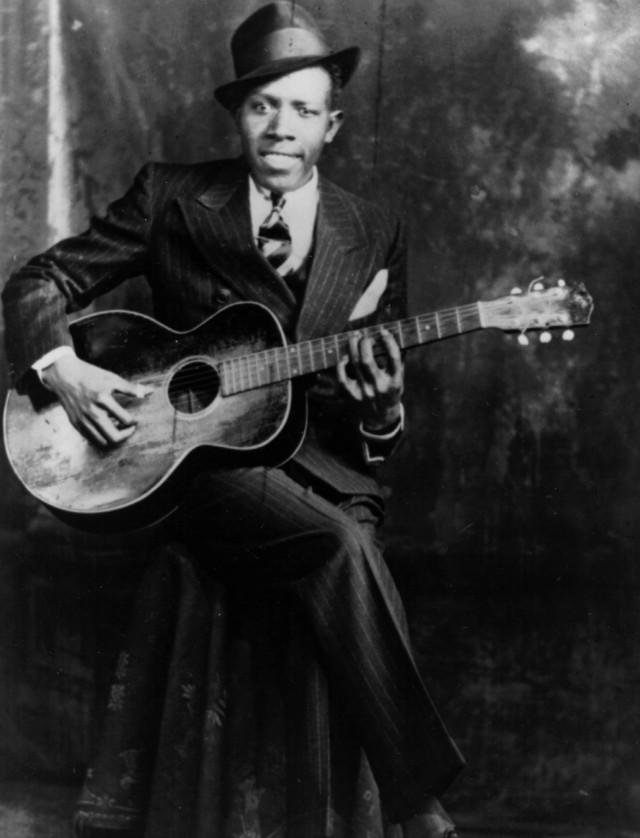 Black and white portrait of musician Robert Johnson.