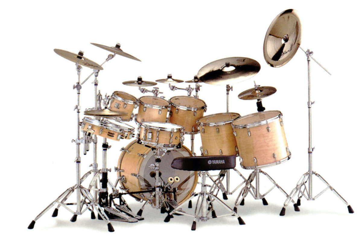 Complete drum kit setup on their stands.