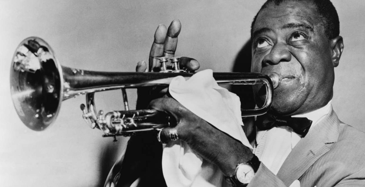 Louis Armstrong playing trumpet.