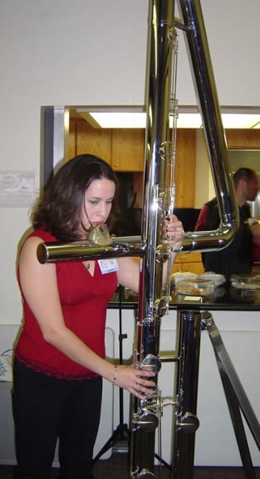 Woman playing double contrabass flute.