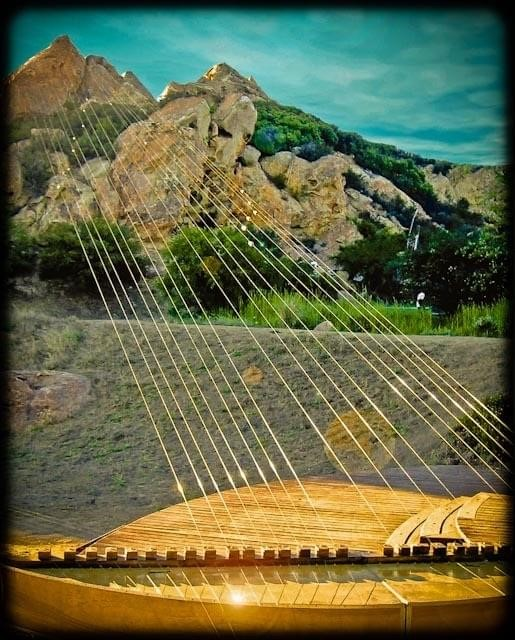 Earth harp installation attached to mountain peaks.