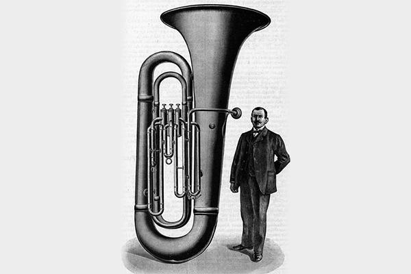 Vintage illustration of man standing next to the Big Carl tuba.