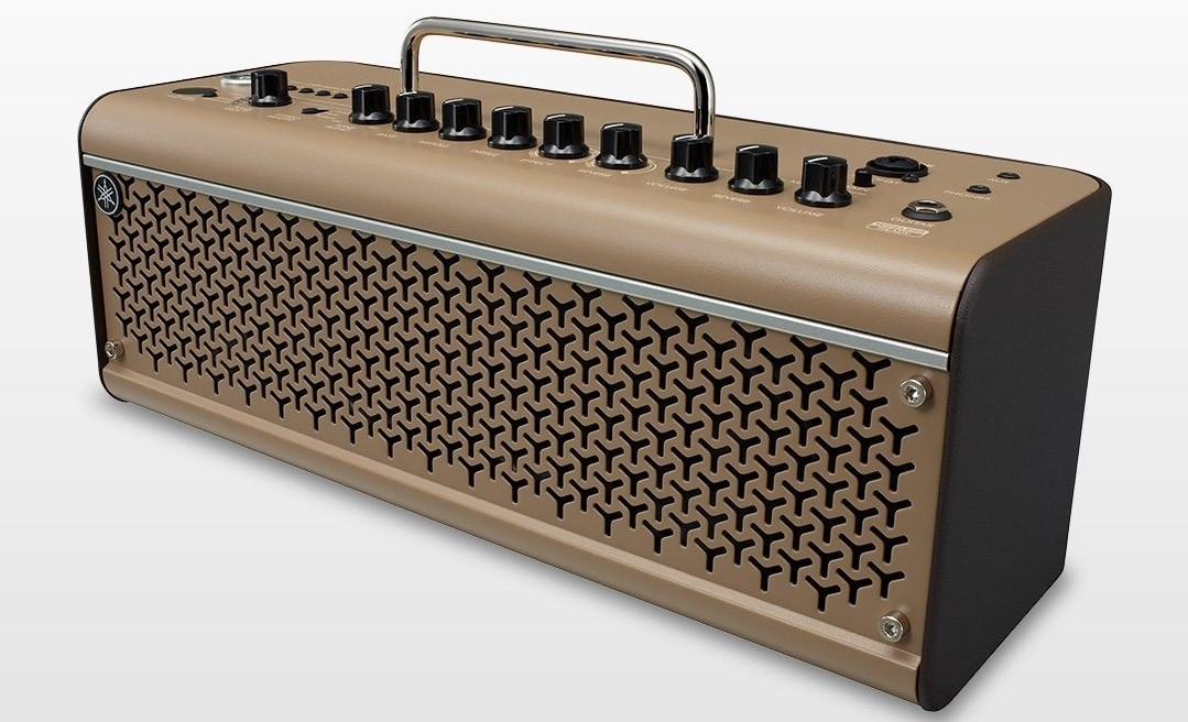Rectangular guitar amp with knobs on top and a handle.