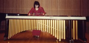 Woman playing a marimba.
