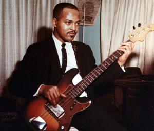 James Jamerson playing bass guitar.
