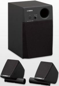 Drum monitor system consisting of two small satellite speakers and a subwoofer.