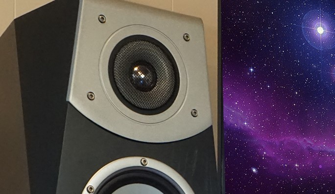 Graphic of star system with audio speaker in front.