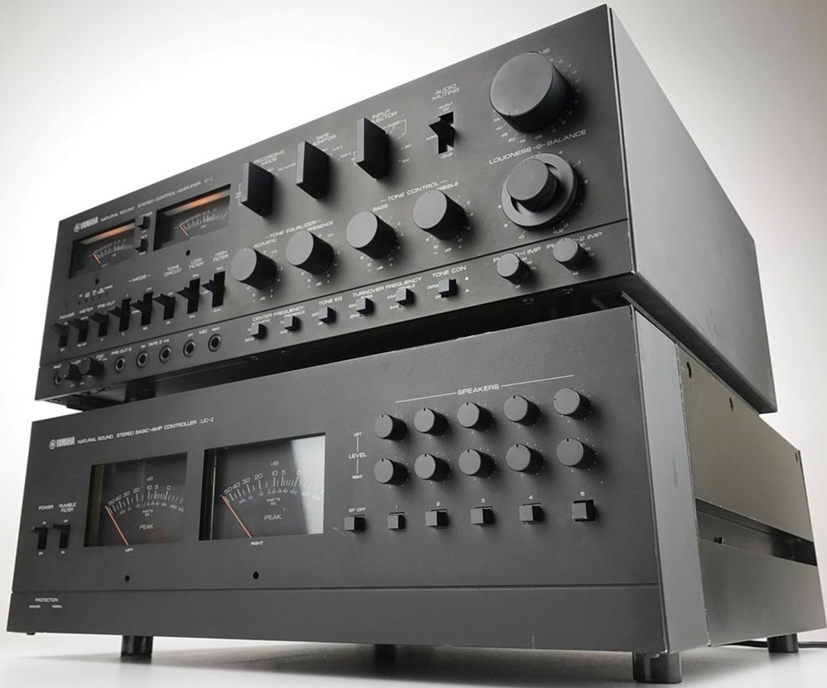 Two amplifiers stacked on top of each other.
