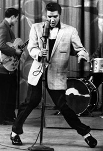 Young Elvis performing with band.