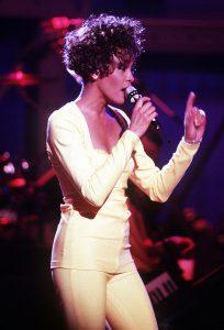 Whitney Houston singing on stage.