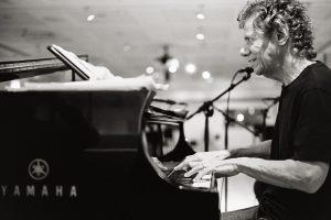 Man playing a Yamaha piano.