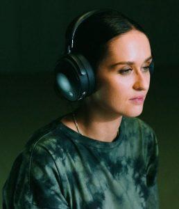 Closeup of woman wearing headphones.