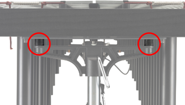 Side view of vibraphone with height adjustment mechanism indicated.