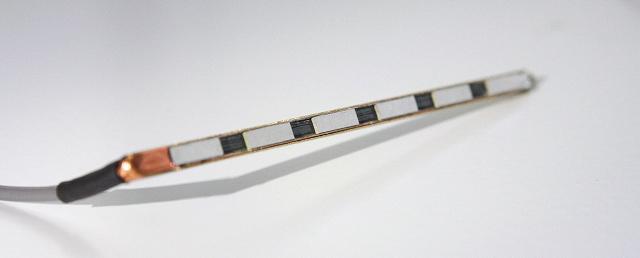 Closeup of long thin L-shaped piece of metal.