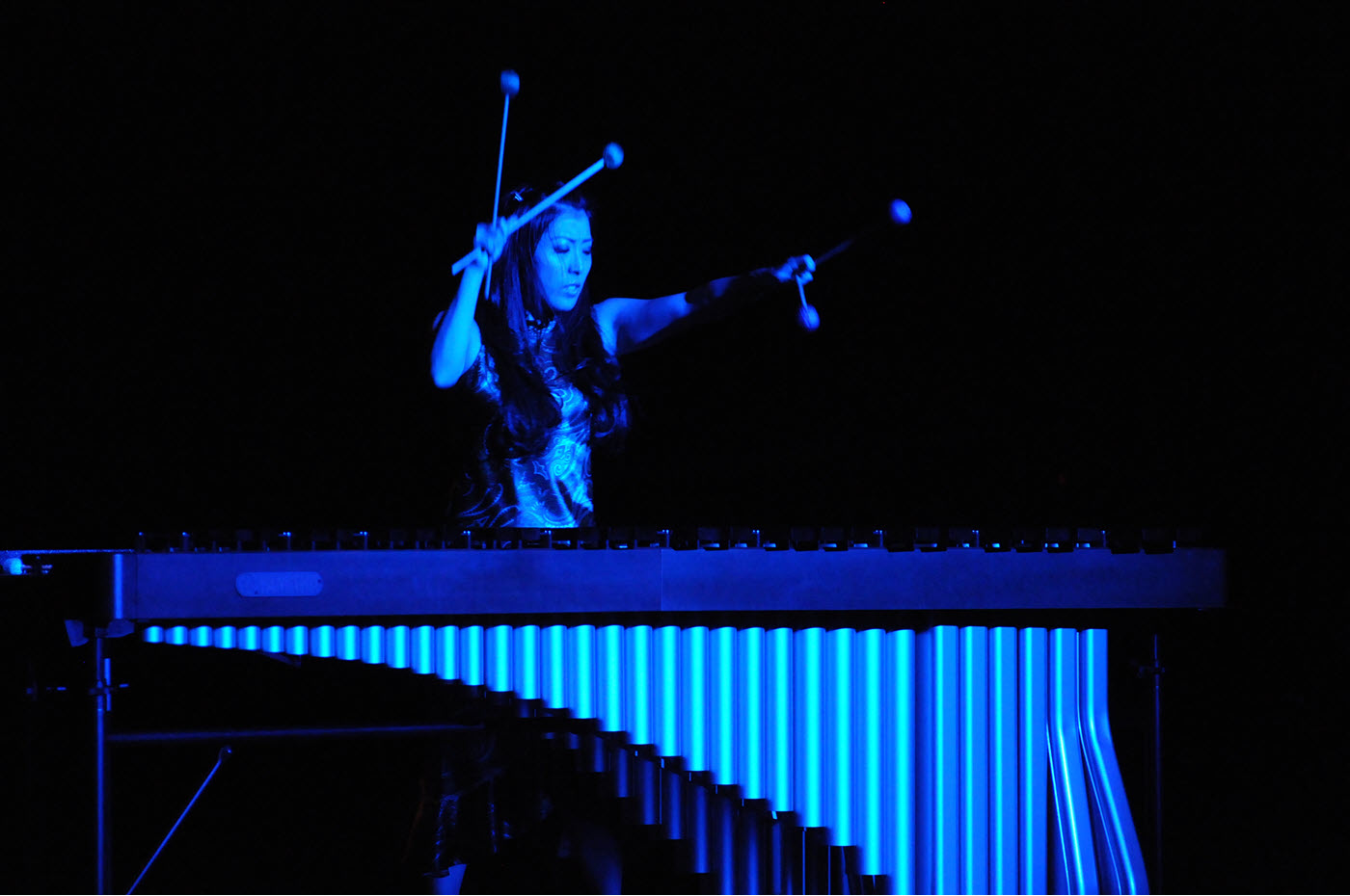 Woman on stage playing marimbas.