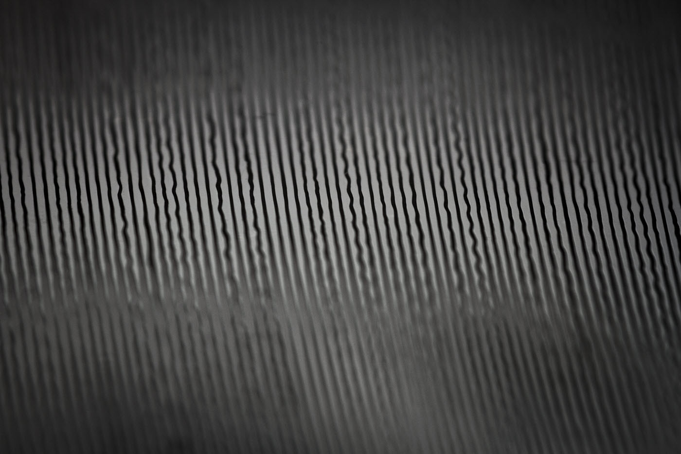 Closeup of the grooves on the aluminum disc.