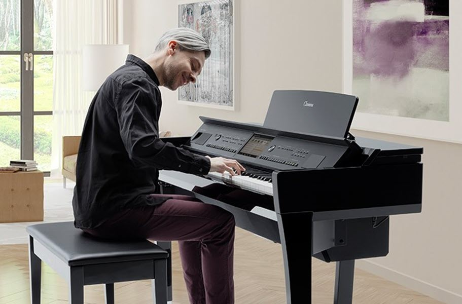 Man playing digital piano in a modern living room.