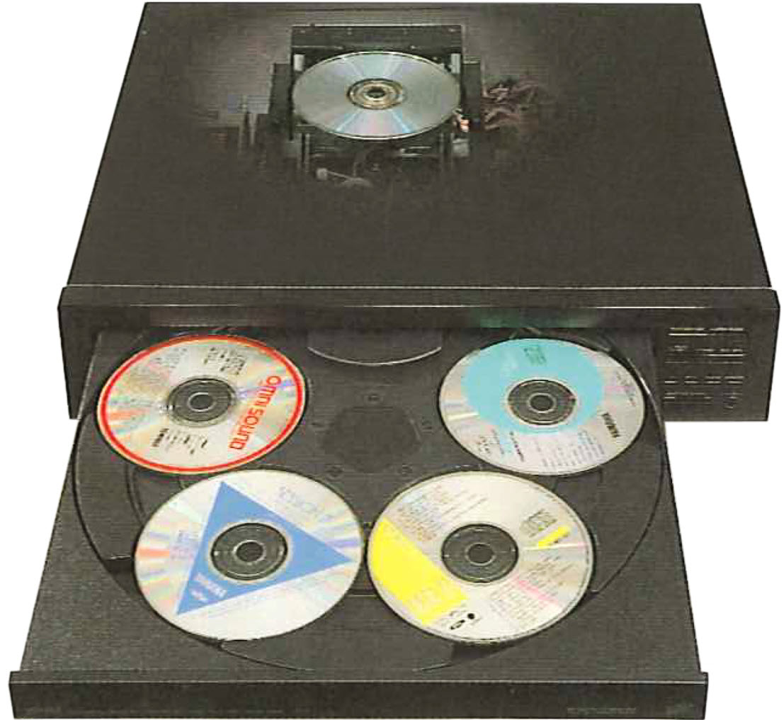 A multi-CD player with the drawer open showing 4 of the 5 CDs in place.