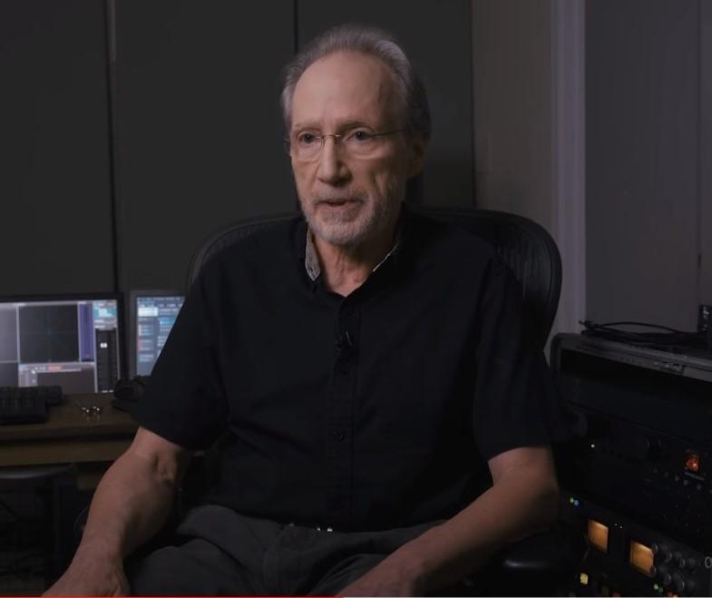 Older man sitting in front of a digital sound workshop.