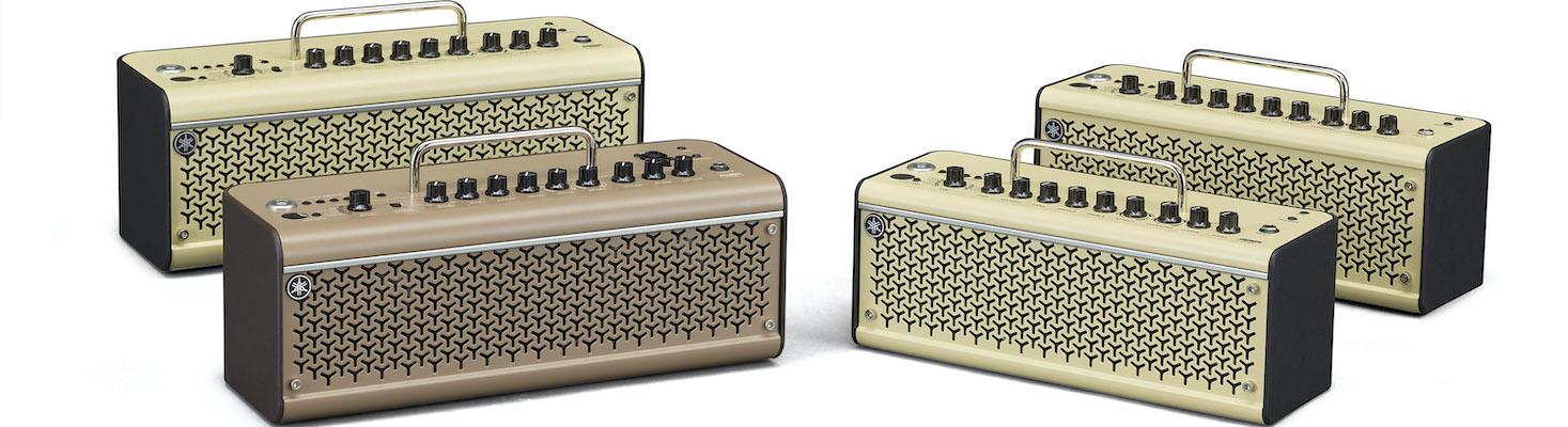 Four small rectangular amplifiers.