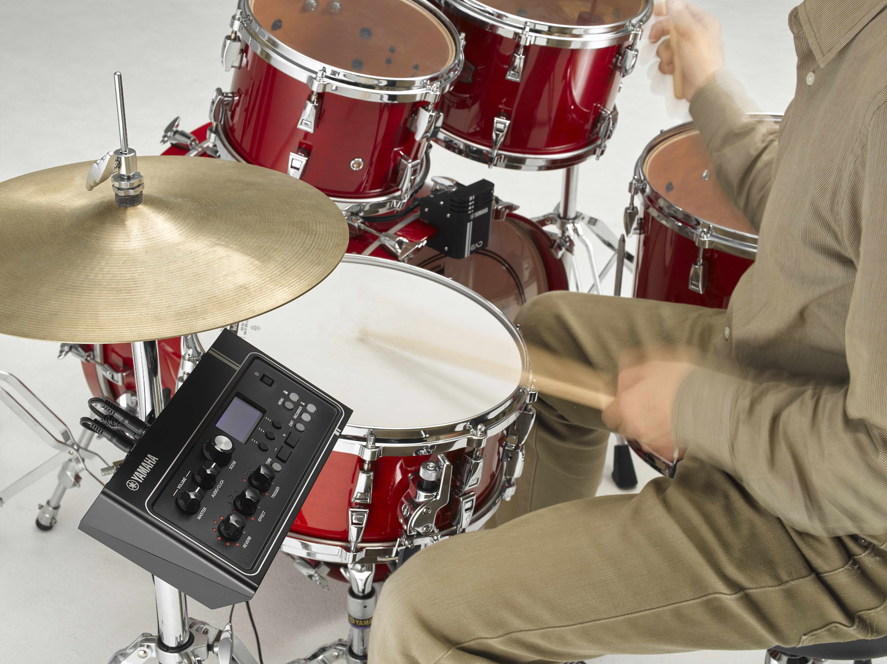 Electronic sensors attached to acoustic drum kit.