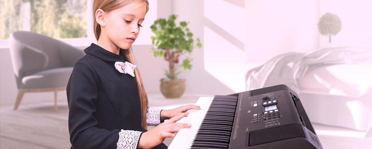 Young girl playing an electronic keyboard.