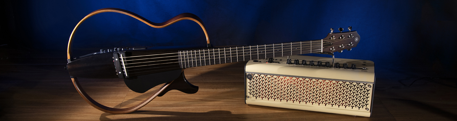Open bodied electric guitar with portable guitar amp.