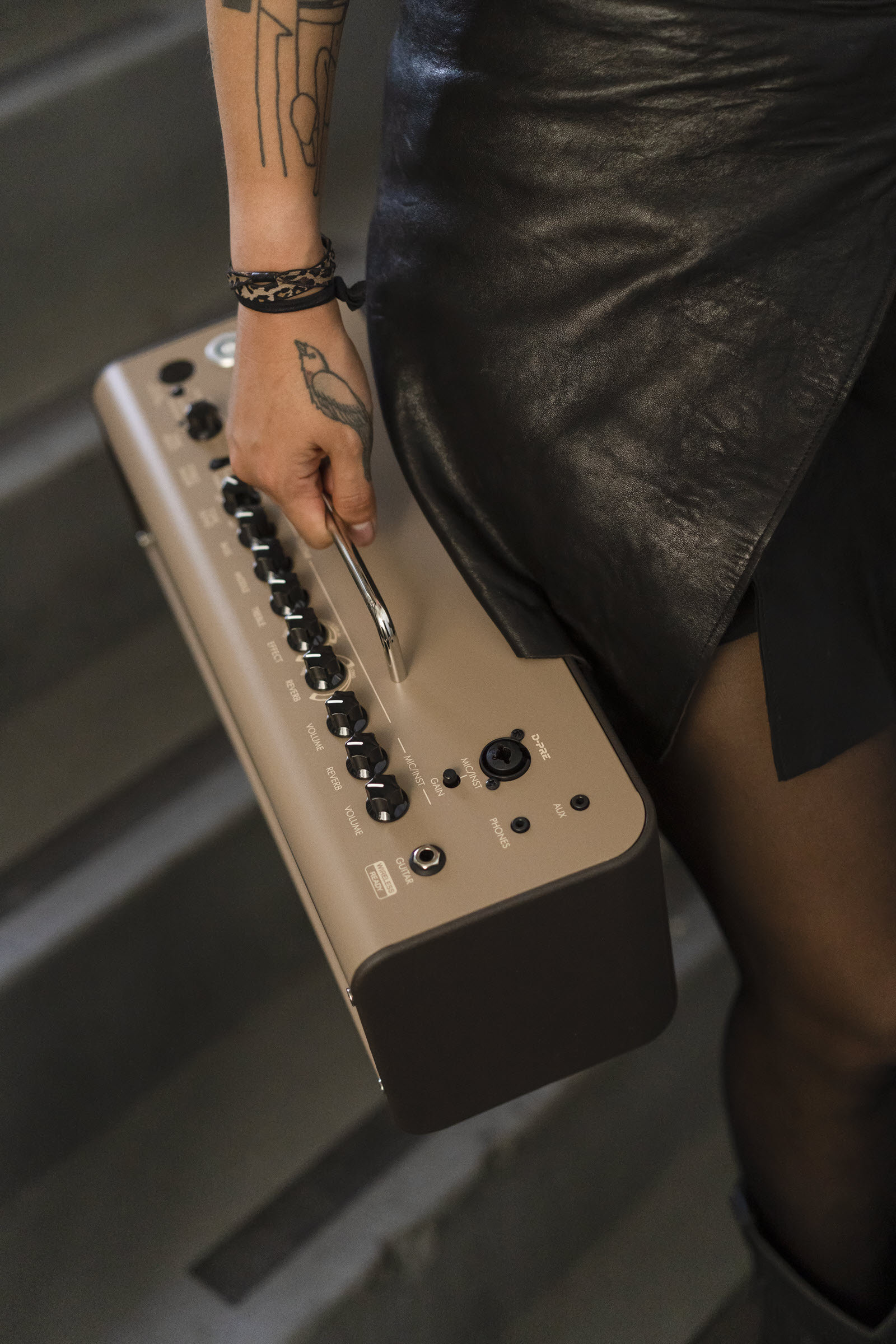 Closeup of portable amp being carried.