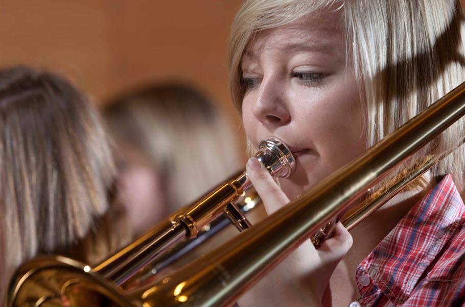 Young girl playing trombone.